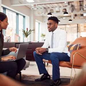 Businesswoman Interviewing Male Job Candidate In Seating Area Of Modern Office, 4 Common Types of Job Interview Questions